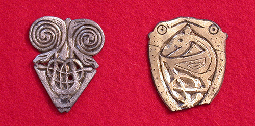 two figurative animal pin heads