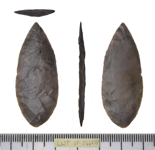 front, side and back of worked flint