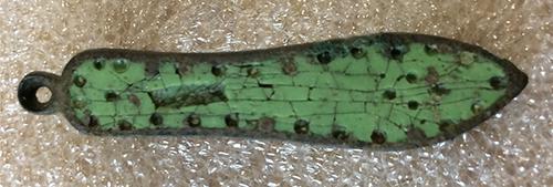 front of green enamelled sandal brooch