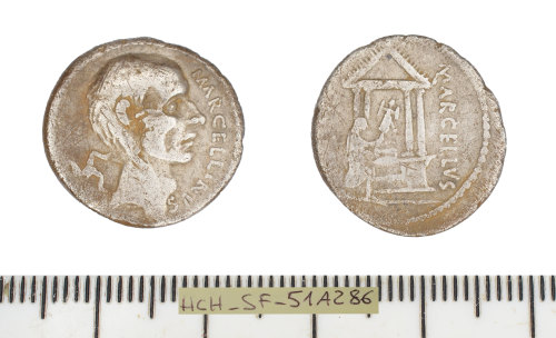 a photo showing front and back of silver coin