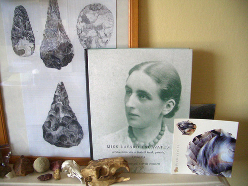 collection of two framed pictures one of flints and the other a portrait of Nina Layard along with collection of artefacts and a flint leaflet