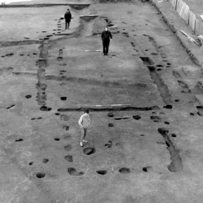 aerial photo of excavation and 3 people