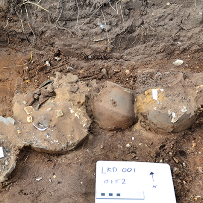 damaged cremation urns in soil
