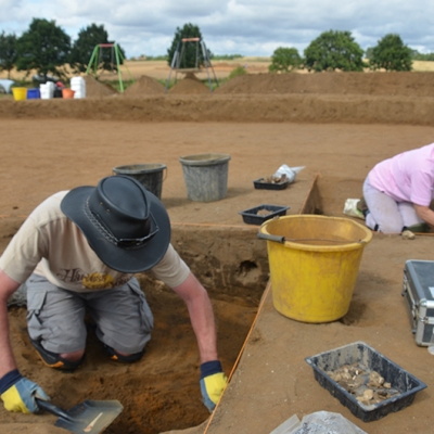 two people excavating with tools