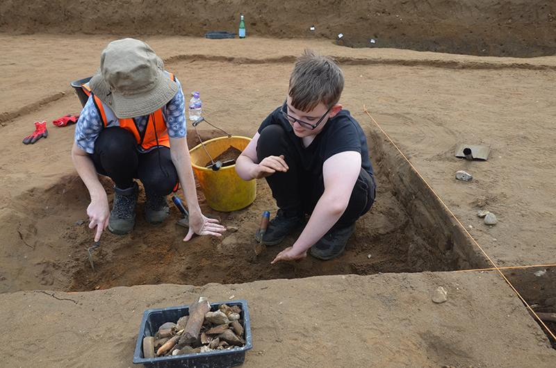 two people excavating